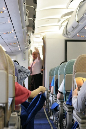 airplane etiquette, travel etiquette, business etiquette tips, polite manners, proper manners